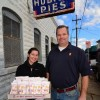 Third-generation owners Courtney Bowman Folse and Drew Ramsey with a tray of Hubig's Pies