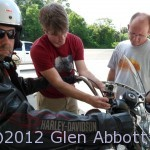 Matt rigs a GoPro HD camera to Chad's bike as Tom assists
